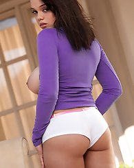 Stacey Rae takes her large naturals out of her purple shirt