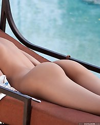 Alexis Love strips by the pool