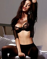 Jessica Jaymes sticks her hand down her black skirt