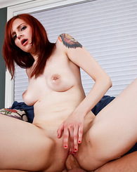 Sexy redhead earns a good grade with her pussy.